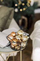Many Christmas tree toys gold decorative balls in metal basket