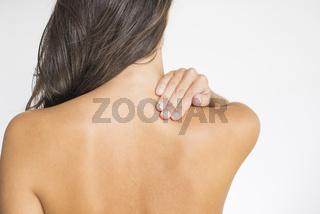 Woman with upper back and neck pain