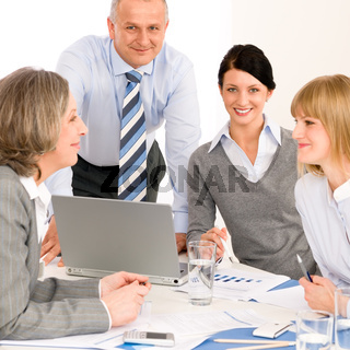 Business team meeting people around table