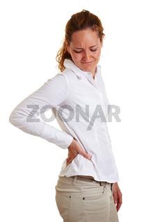 Geschäftsfrau hält ihre schmerzende Hüfte