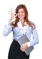 Beautiful businesswoman showing ok sign