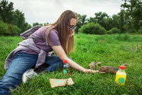 Woman feeding gopher