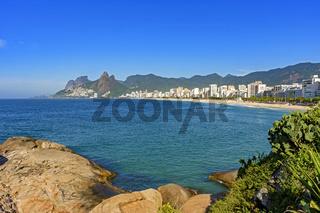 Ipanema beach in Rio de Janeiro with mountains