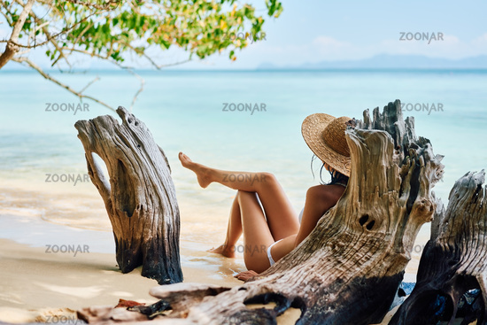 Pretty young woman enjoy sea on tropical paradise beach