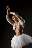 Sexy female ballet dancer in lace bolero