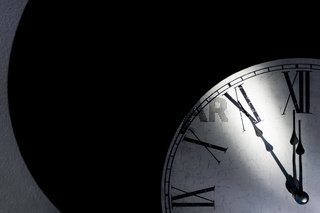 Vintage wall clock showing five minutes to midnight as a symbol for time running out