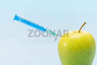 Green apple and syringe genetically modified foods