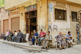 men smoking shisha in cairo old town