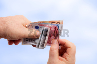 Hands holding banknotes