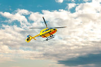 Paramedic rescue helicopter against blue cloud sky. Starting helicopter, flying ambulances,