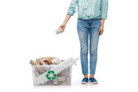 woman sorting paper waste