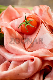 Mortadella slices with red pepper