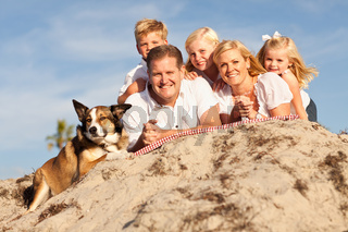 Happy Caucasian Family Portrait at the Beach