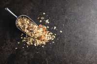 Beakfast cereals in scoop. Healthy muesli with oat flakes, nuts and raisins