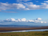 view across morcambe bay from grange over sands in cumbria with the south lake district visible in the distance