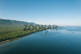 Fantastic panorama of Lake Baikal at sunset is a rift lake located in southern Siberia, Russia. Baikal lake summer landscape view. Drone's Eye View.