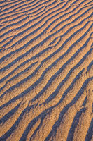 The sand lies in light waves