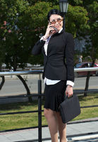 Caucasian businesswoman talking cellphone