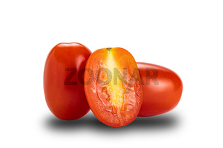 Side view of whole and a half ripe plum tomatoes on white background with clipping path.