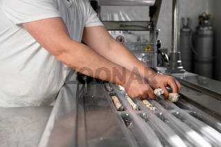 Sausages. Packing line of sausages. Industrial manufacture of sausage products.