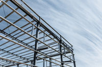steel frame mill building and blue sky