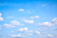 Light blue summer sky with small heap clouds