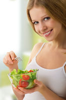 beautiful girl with vegetable vegetarian salad