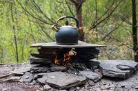 Making a pot of tea while camping outdoor