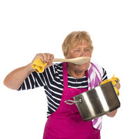 Elder woman with spoon and pan