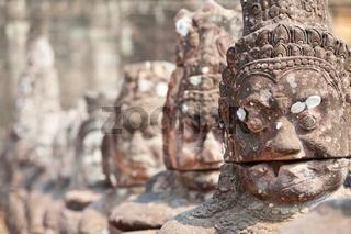 ancient stone Angkor statues