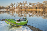inflatable whitewater kayak on a lake shore