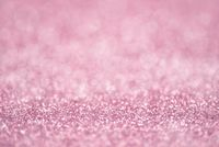 Texture of light pink glitter dust surface, luxury background with bokeh