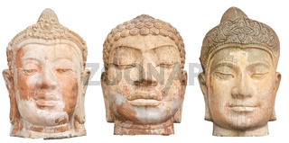 Three Buddha heads isolated on white