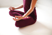 Young woman meditating in yoga pose