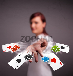 Young woman playing with poker cards and chips