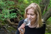 Enjoying a drink on the shore of a river