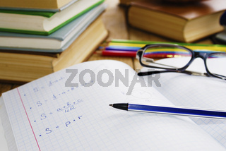 The textbook with pen