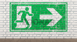 Exit sign on white brick wall