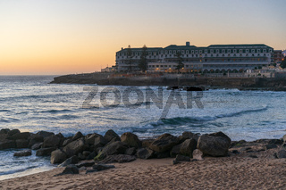 Ericeira Vila Gale Hotel at sunset with Baleia beach in Portugal