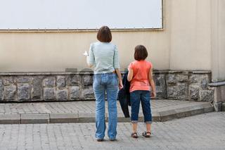 children look at advertising banner
