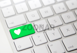 White computer keyboard with green 'heart' button