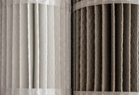 Clean and dirty HVAC filters side by side to illustrate the dfifference