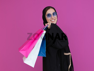 Happy muslim girl posing with shopping bags
