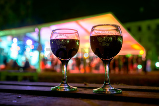 Lviv, Ukraine, Oct 23, 2021: Two wine glasses with Lviv Cheese and Wine Festival logos during the event.
