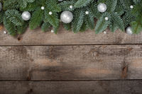 Spruce twigs on a wooden background