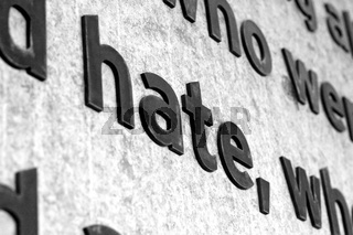 The word HATE carved into stone