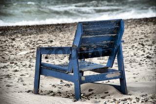 Holzstuhl am Strand