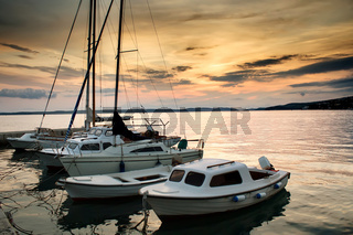 Fishing boats in Adriatic sea with sunset light