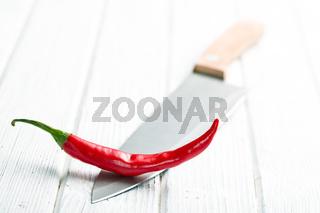 chili pepper on knife