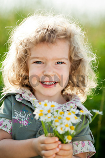 Child with bunch of spring flowers